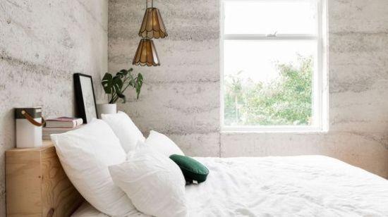 dormitorio con hormigon visto